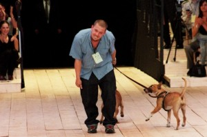 Alexander McQueen on the runway with his dogs